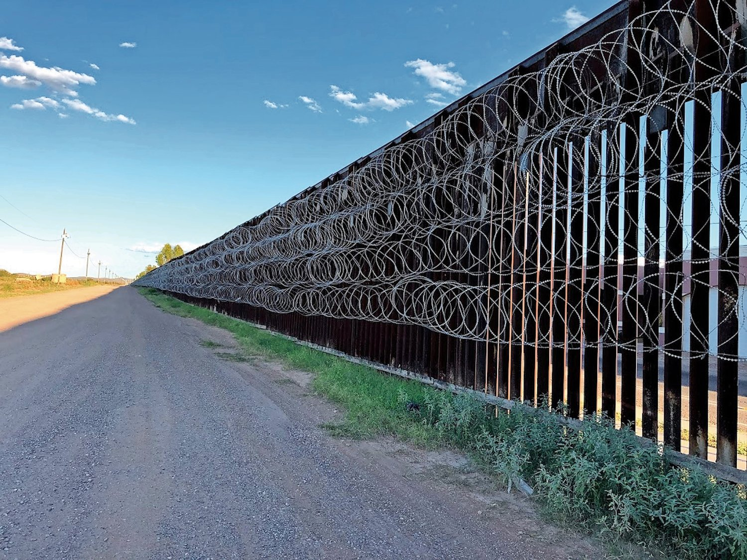 A portion of the U.S.-Mexico border in Douglas, Ariz., boasts curls of barbed wire.