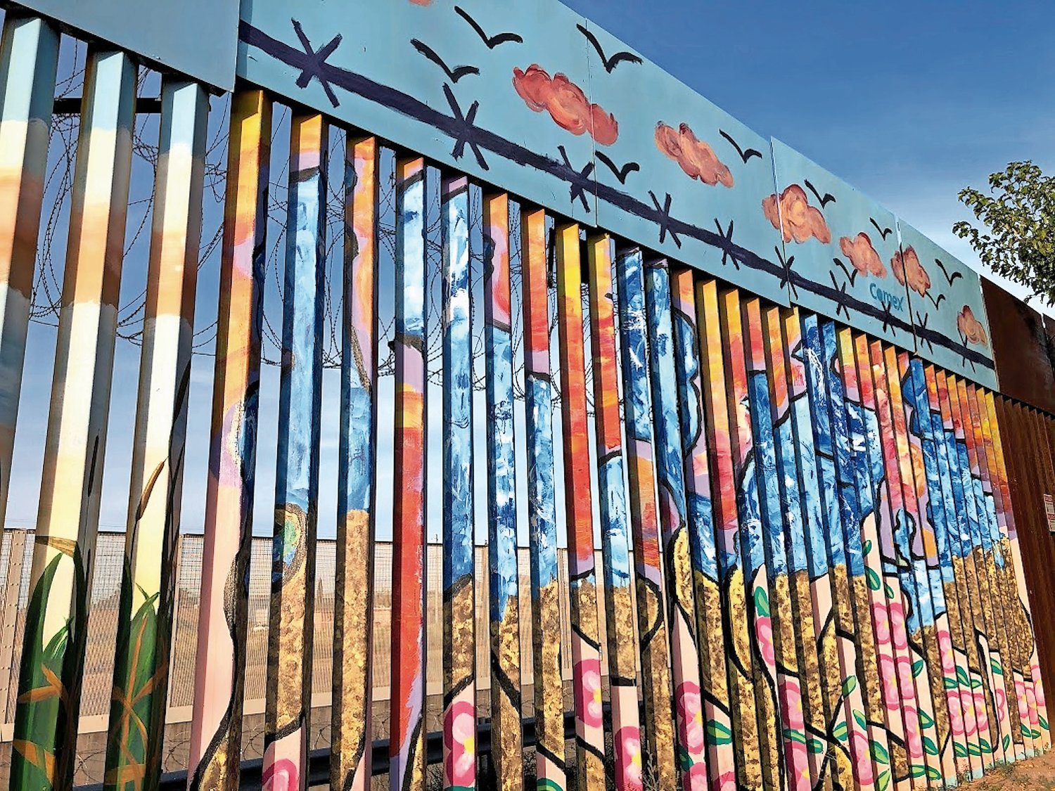 In Agua Prieta, on the Mexican side of the border, many portions of the border wall are painted in an array of colorful murals.