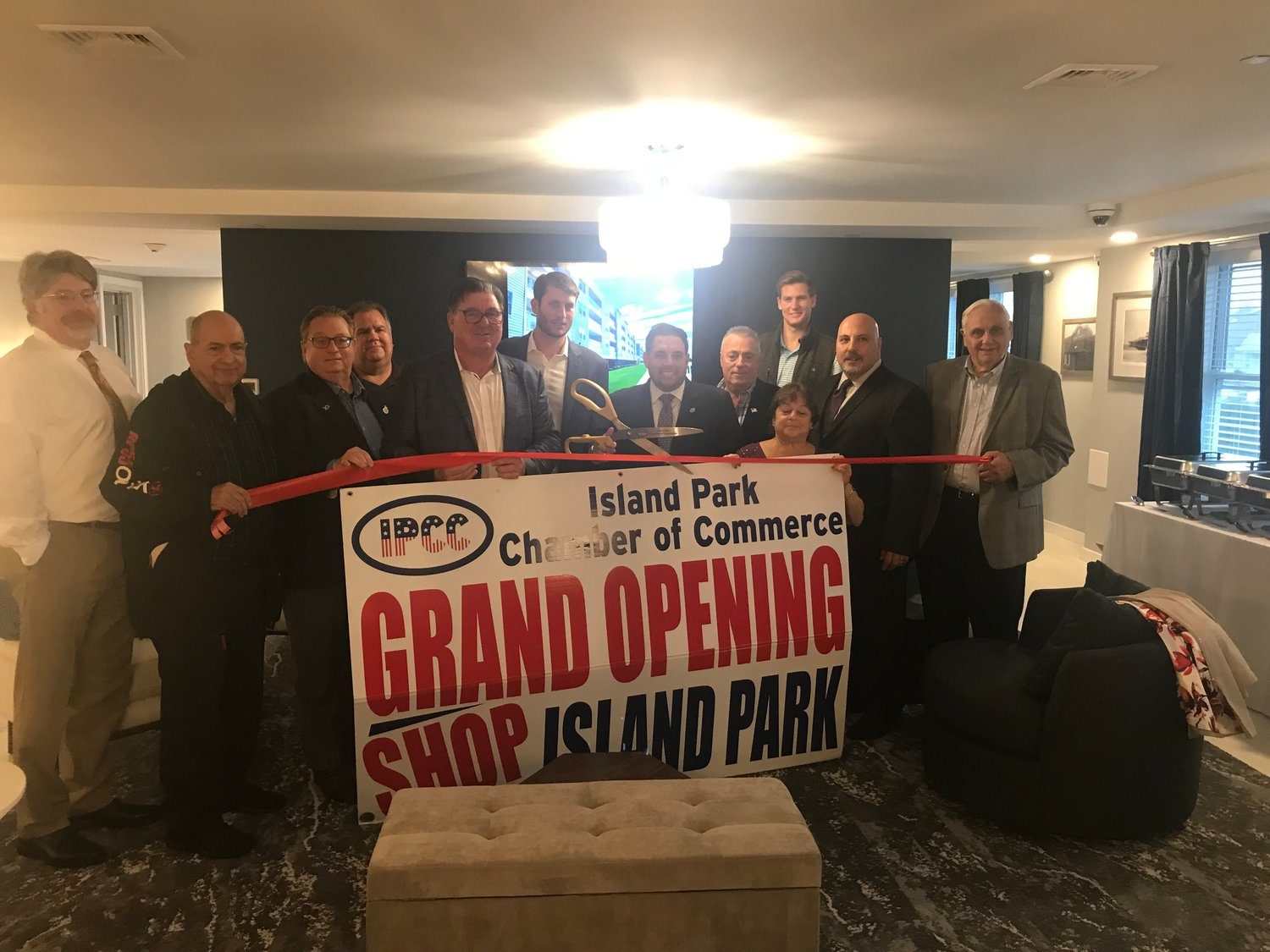 Members of the community, elected officials and Chamber of Commerce representatives attended a ribbon cutting ceremony for the grand opening of the Channel Club apartment complex in Island Park on Oct. 30.