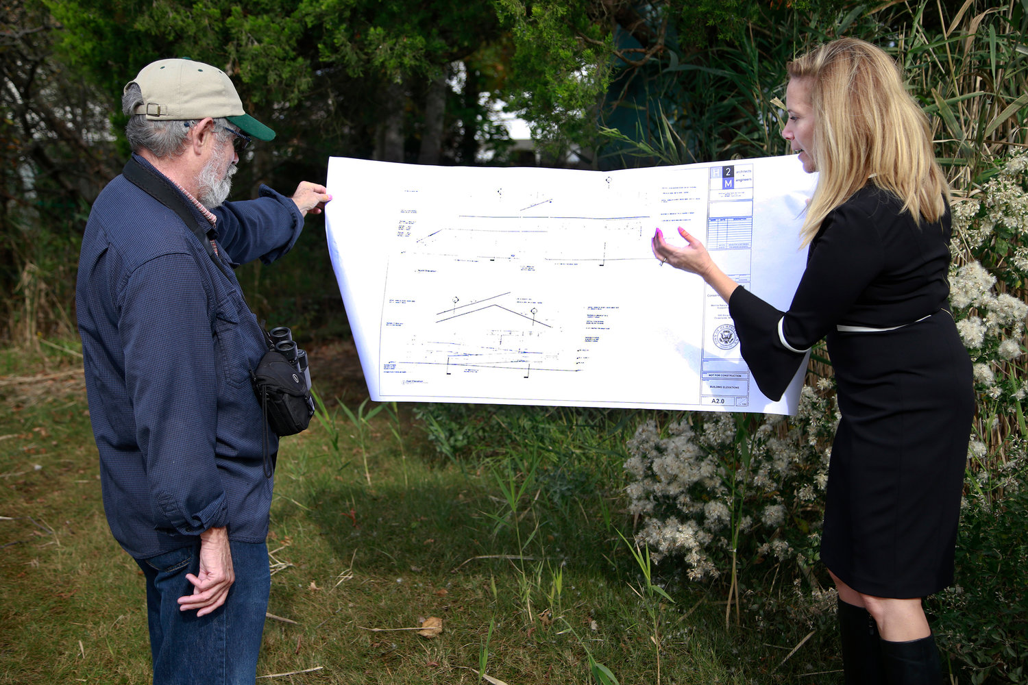 Hempstead Town Supervisor Laura Gillen, right, looked over the plans for the revitalized Oceanside Marine Nature Study Area with Audubon Society member Jim Brown.