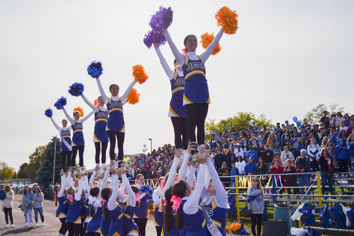 East Meadow's cheerleading squad riled up the crowd during halftime.