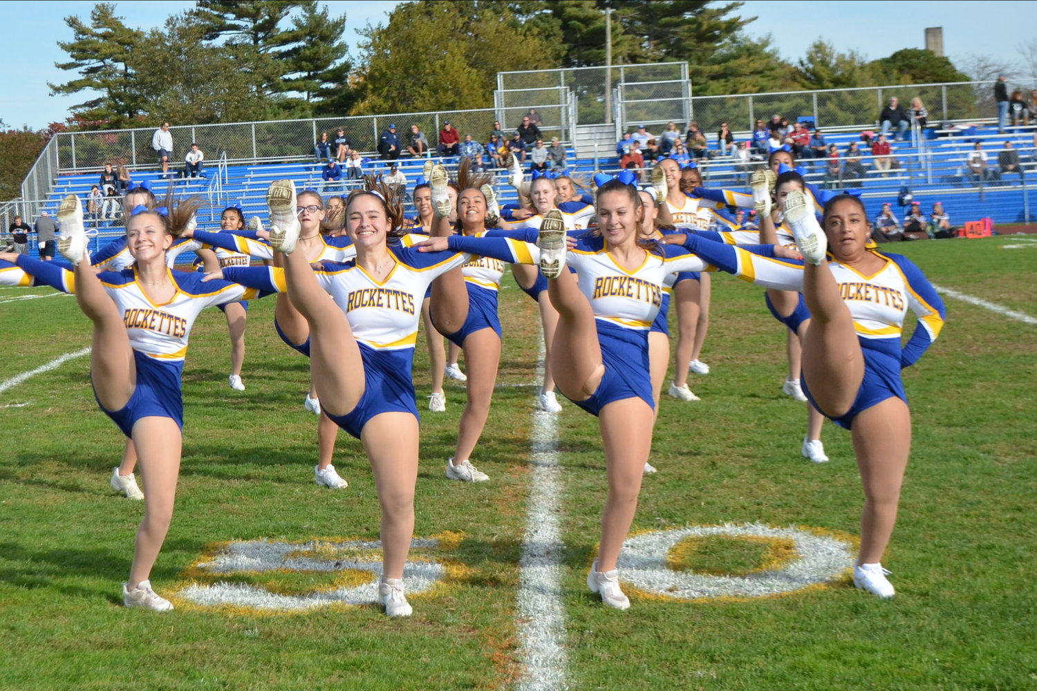 The East Meadow Rockettes performed their routine for a festive halftime show.