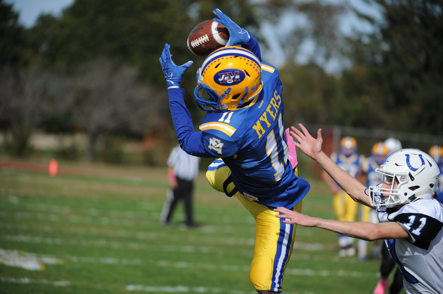East Meadow High School football player Devin Myers dove forward to make a catch.