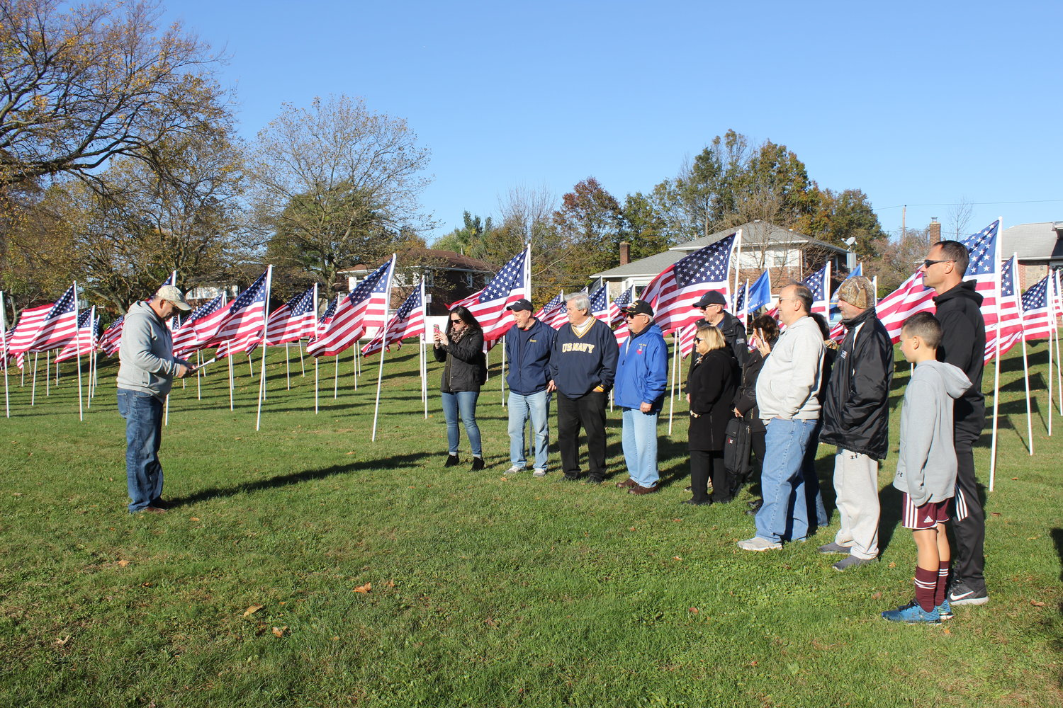 Each flag is dedicated to a member of the East Meadow community who served in the U.S. military. Kiwanis President Alan Beinhacker addressed the crowd at W.T. Clarke High School.