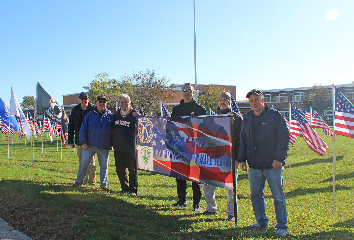 East Meadow Kiwanis collaborated on the Field of Honor project with the Athletes Helping Athletes service clubs at both high schools.