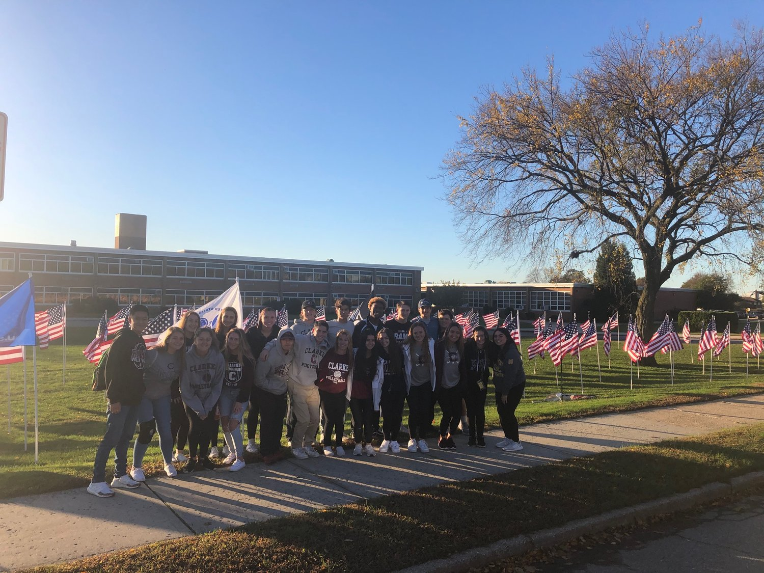 The W.T. Clarke High School Athletes Helping Athletes service club visited the Field of Honor at their school.