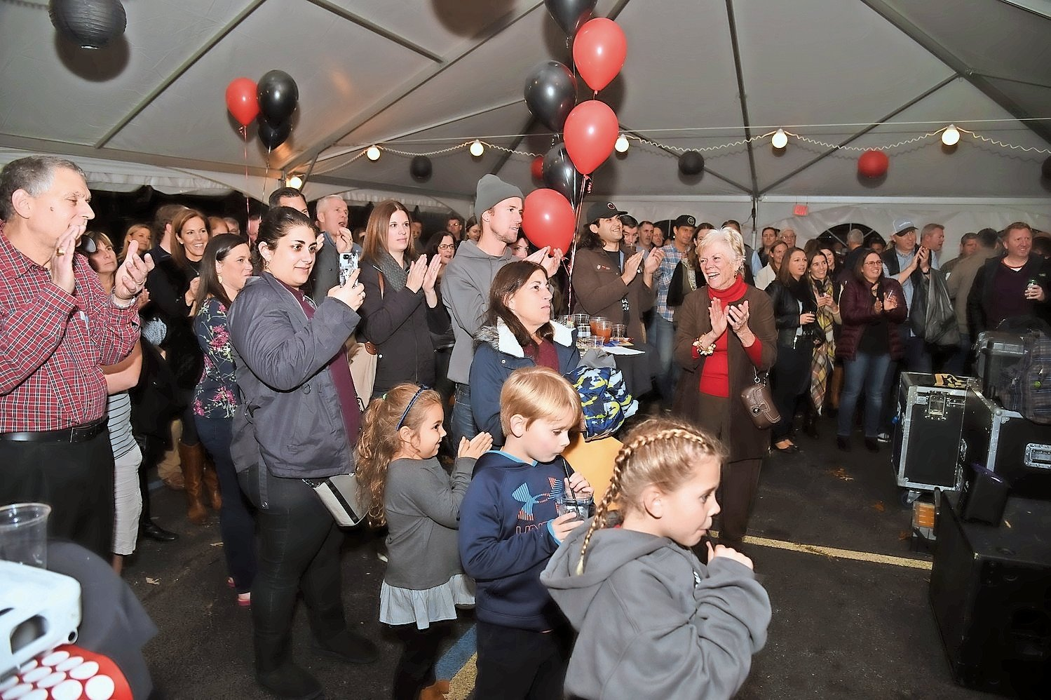 Community members gathered last year for the event in a large, heated tent, and the fundraiser will once again be held outside St. Mark's Church on Hempstead Avenue.