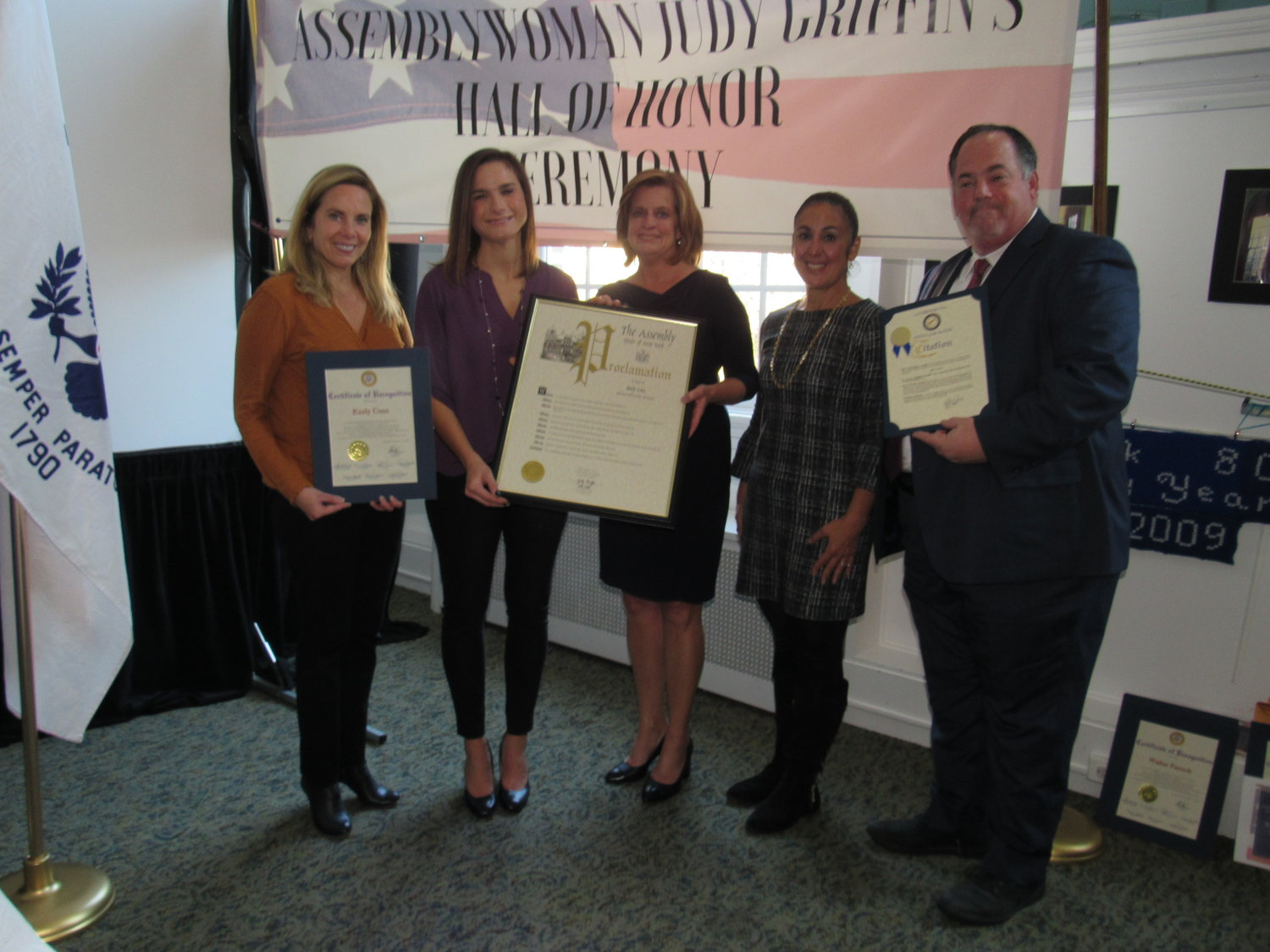 Keely Coco, second from left, of Lynbrook Veterans of Foreign Wars Post 2307, was recognized at the event by its host, Assemblywoman Judy Griffin, center, and, from left, Hempstead Town Supervisor Laura Gillen, Town Clerk Sylvia Cabana and Lynbrook Deputy Mayor Michael Hawxhurst.