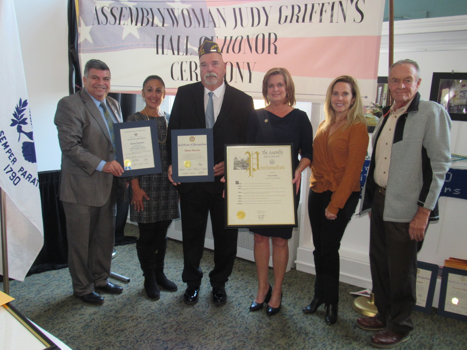 Harry Hansen, third from left, of Veterans of Foreign Wars Post 335 in East Rockaway, was honored by, from left, Mayor Bruno Romano, Cabana, Griffin, Gillen and East Rockaway Village Trustee Steve Fried.