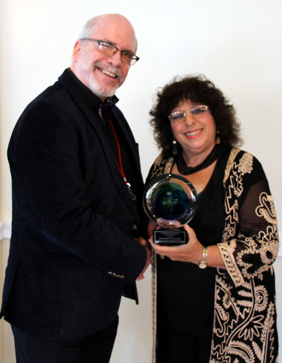 Long Island Arts Council at Freeport Executive Director Laurence Dresner, right, presented Joanne Phillips from Long Beach with the Arts Recognition Tribute Award (ARTY).