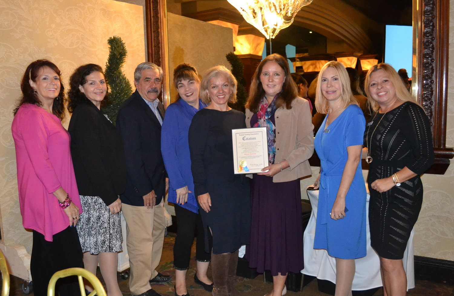 Susan Rassekh, fourth from the right, received the 2019 Nassau Council of Chamber of Commerce's Small Business Person of the Year Award.
