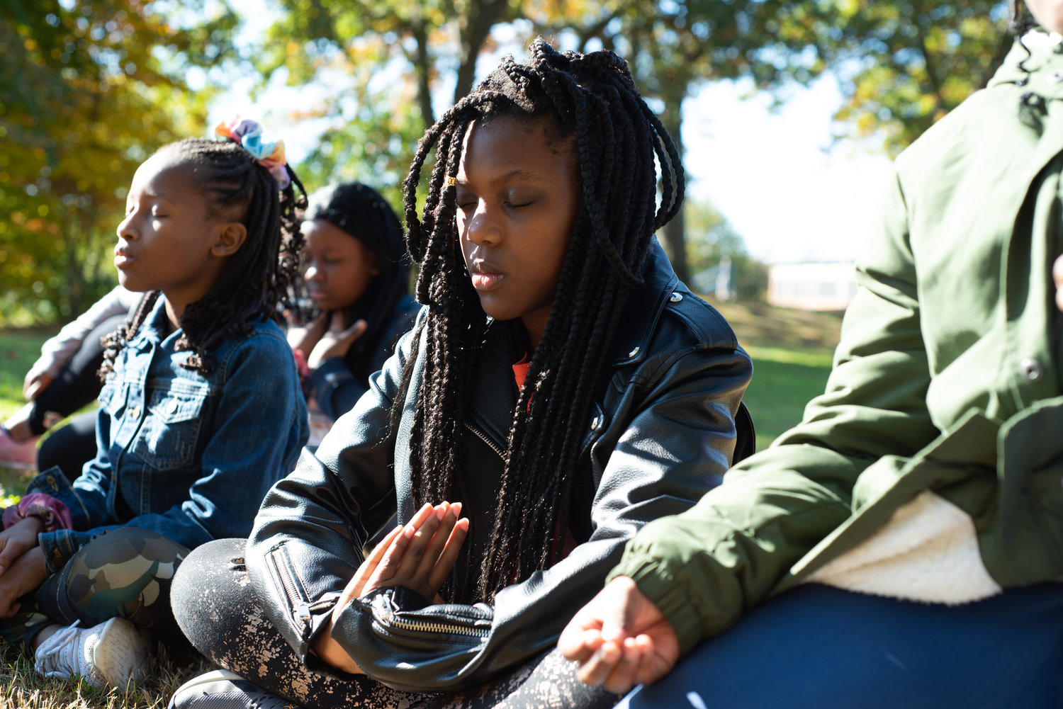 Supplemented by storytelling and a nature walk, students participated in group meditation.