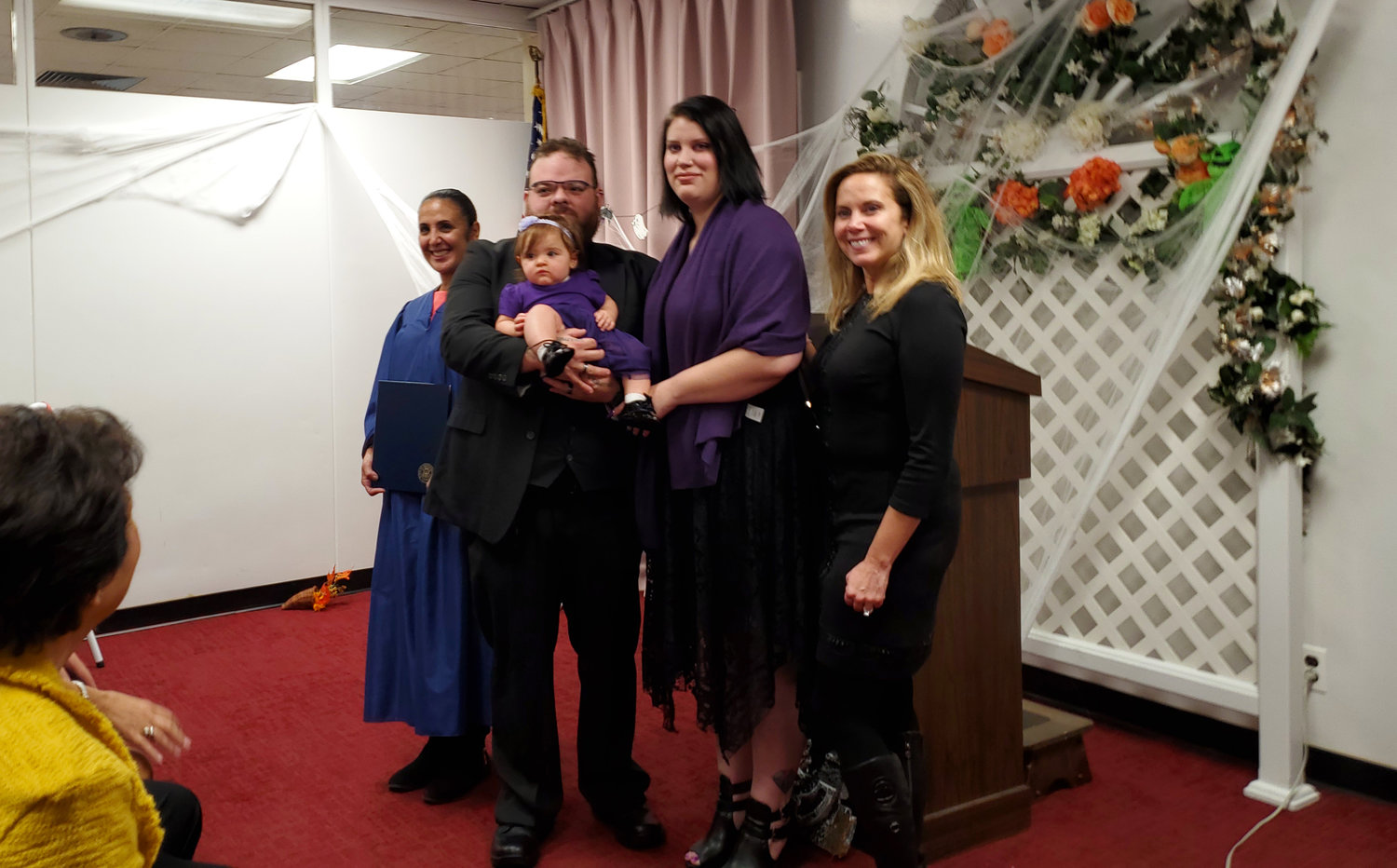 Hempstead Town Clerk Sylvia Cabana, left, officiated at the marriage of Alexander Castro, 30, of Seaford, and Amanda Caroleo, 27, of Garden City, on Halloween, with some assistance from Town Supervisor Laura Gillen.