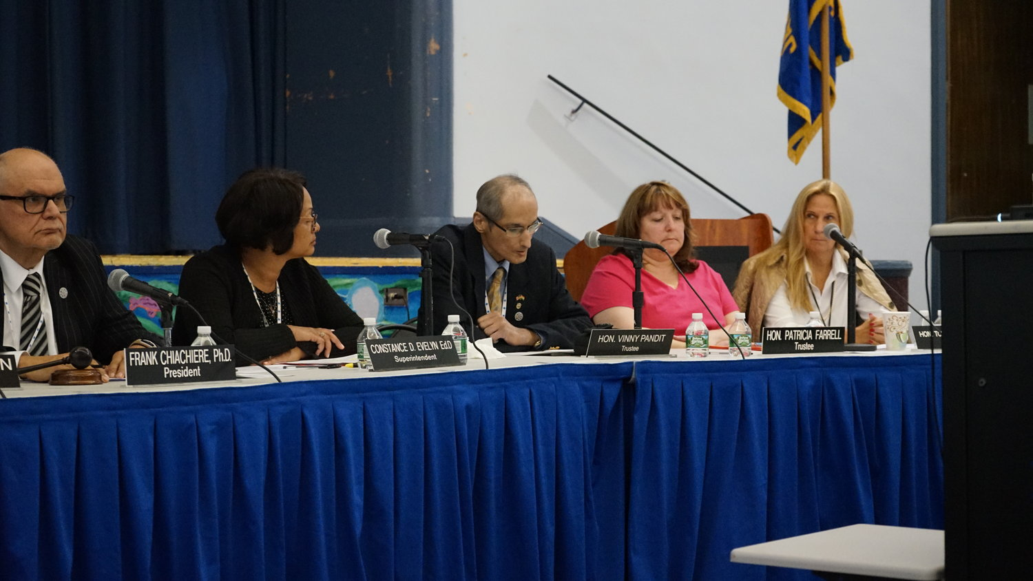District 13 Board of Education Trustee Vinny Pandit, third from left, has tendered his resignation after a series of controversial comments he made on social media.
