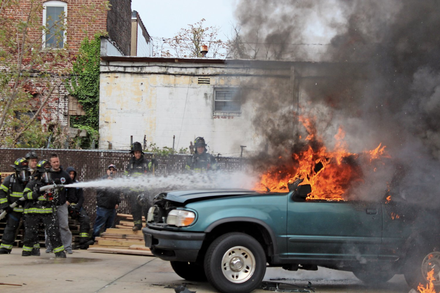 Elmont firefighters extinguished a simulated car fire at the fire department's annual Open House on Sunday.