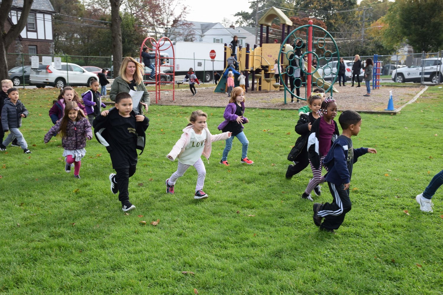 Kindergartners ran from one activity to the next.