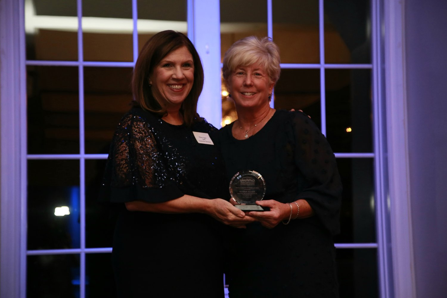 McDonald, right, was presented with the Community Mainstreaming Associates' John Walter Humanitarian Award on Nov. 7 by Executive Director Eileen Egan.