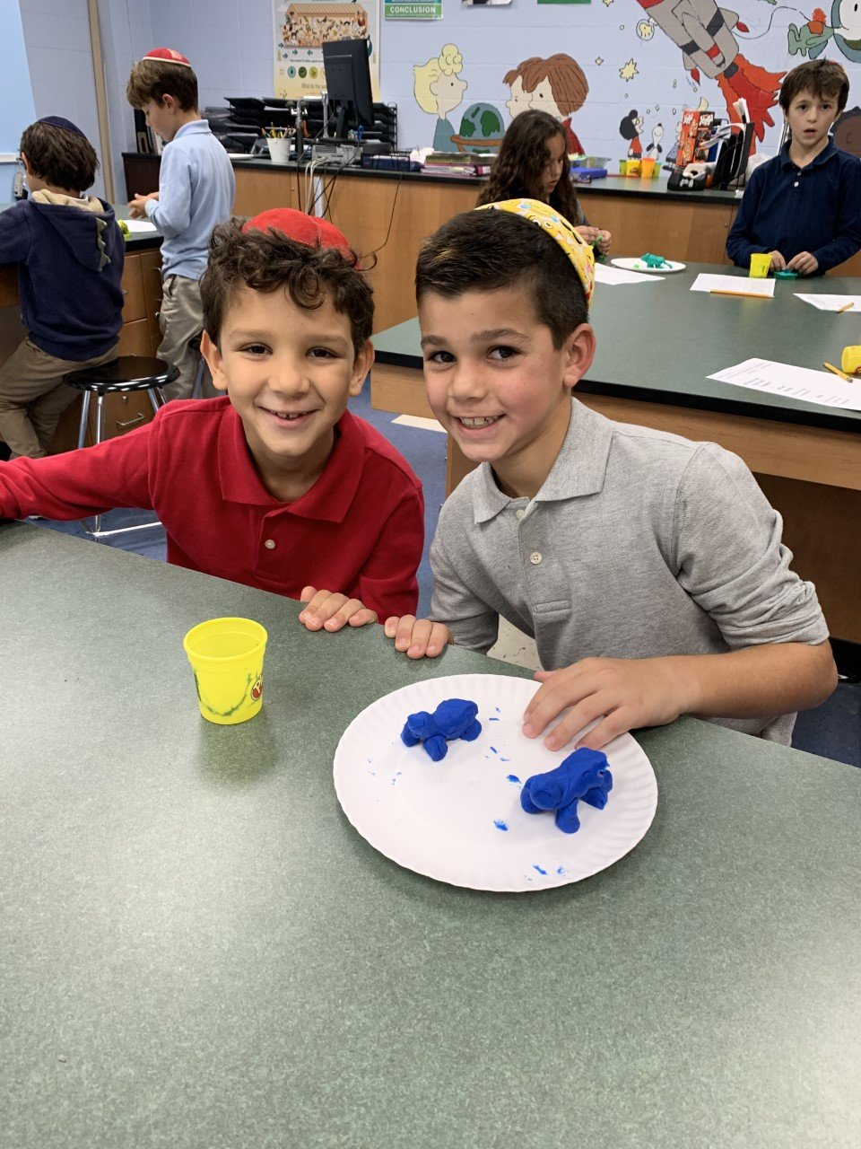 Brandeis School third-graders Rom Harel, left, and Aviv Shabtay, with their play dough-made invertebrate facsimile animals.