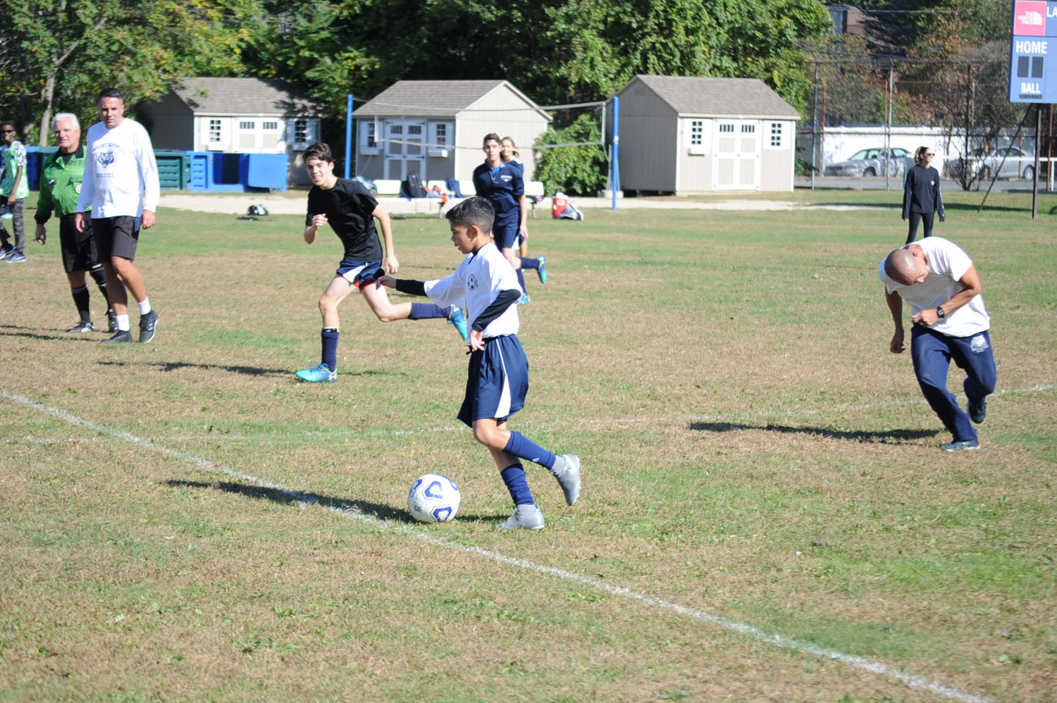 Eighth-grader Daniel Gonzales handled the ball in the teachers vs. students game.