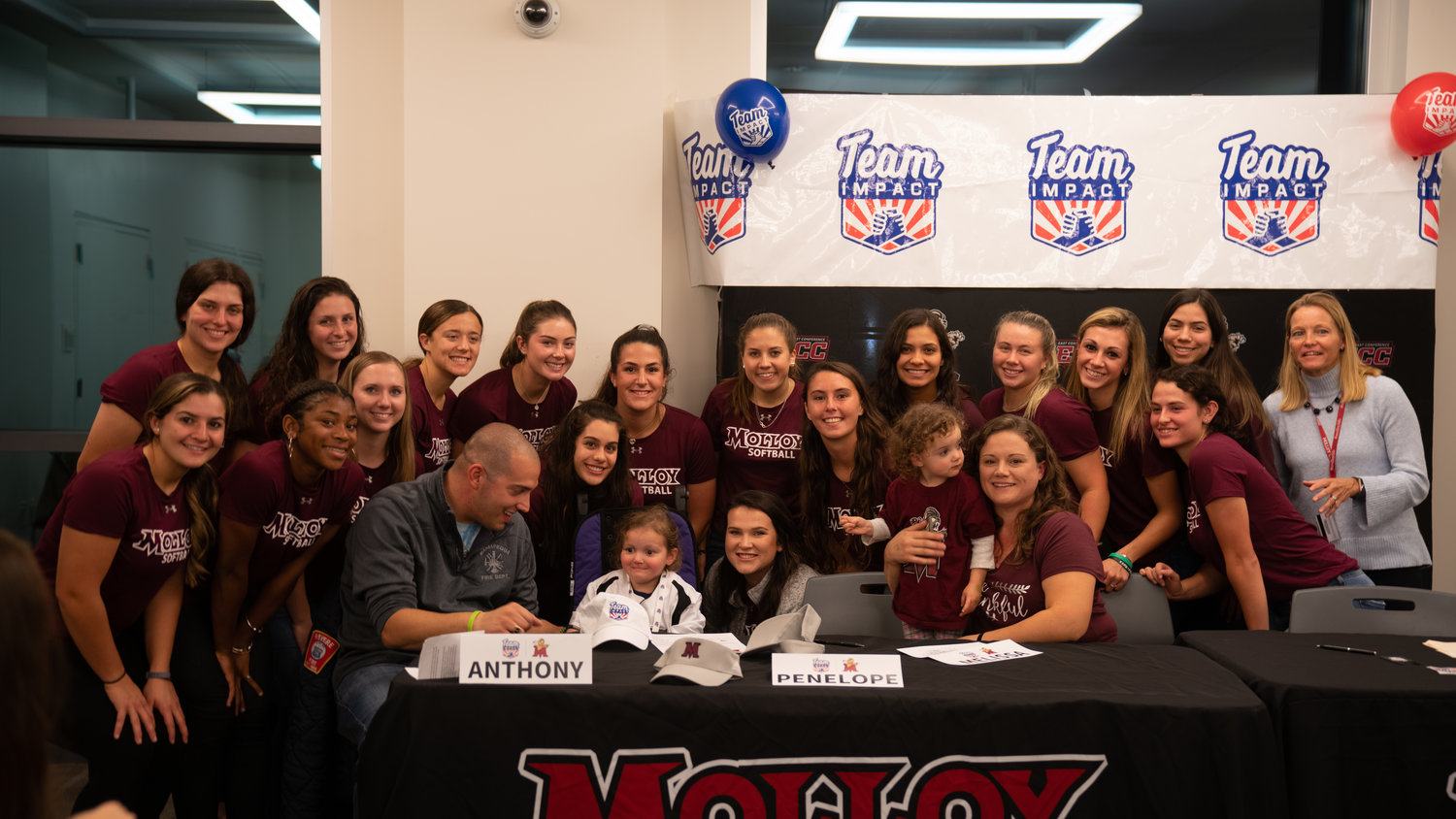Penelope DiChiara and her family with the Molloy softball team.