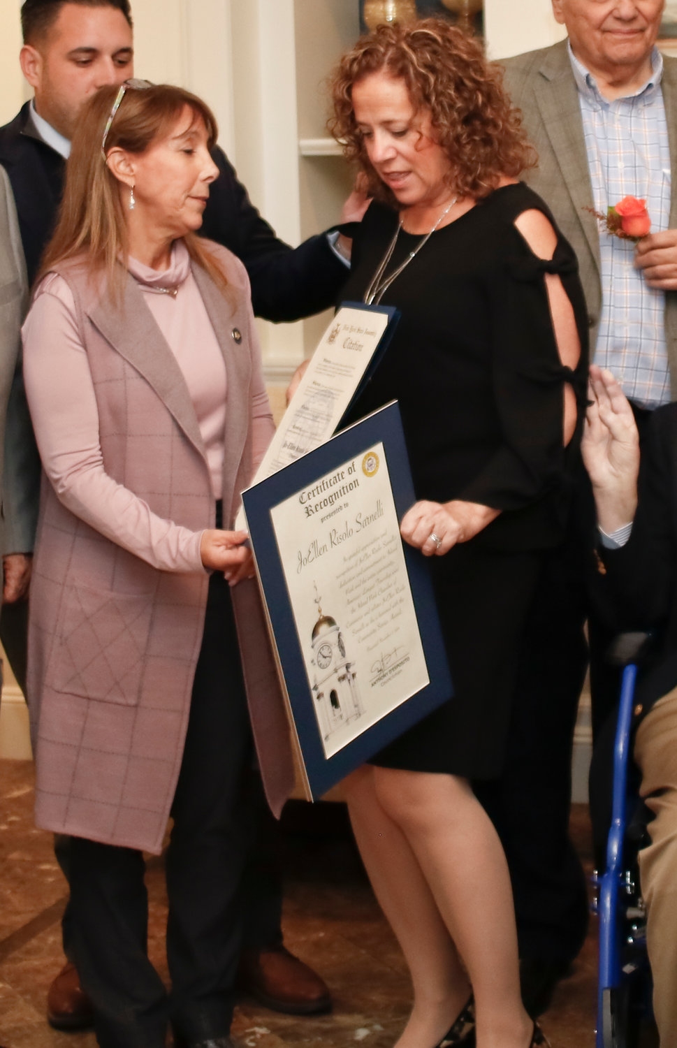 Jo-Ellen Risolo Sarnelli, right, was congratulated by State Assemblywoman Melissa Miller after receiving the Community Service Award.