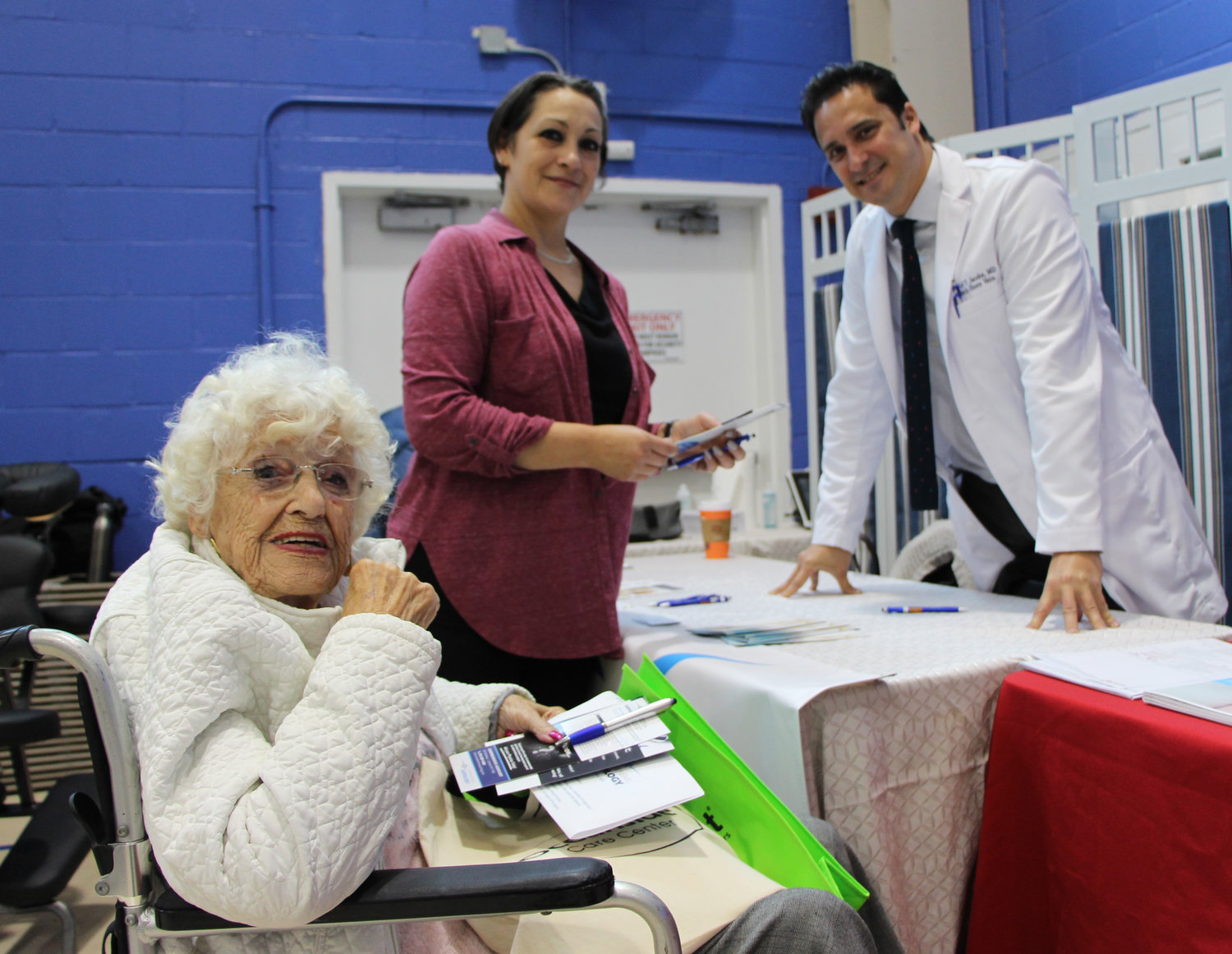 Dr. David Jacobs, of South Shore Vein, far right, gave information to an attendee.