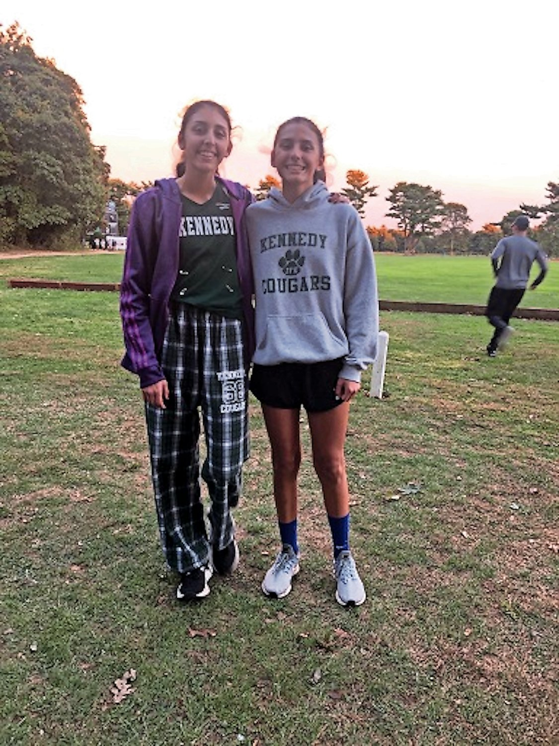 Maya, left, and Marissa Spottiswood, of South Merrick, are the first teammates and siblings in John F. Kennedy High School history to complete a 5K in under 20 minutes at the same cross-country meet.
