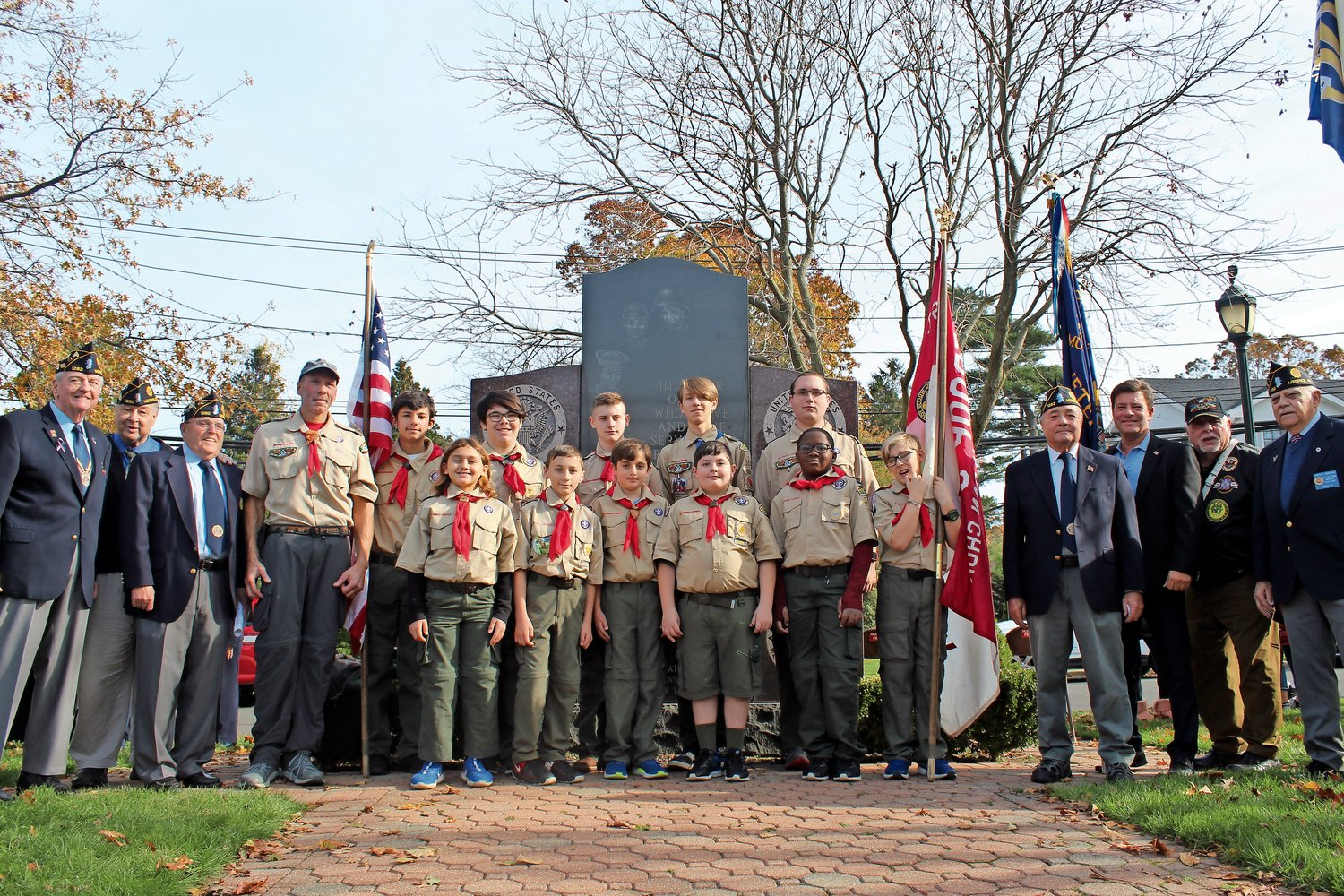 Members of Boy Scout Troop 351 acted as flag bearers during American Legion Post 1282's annual Veterans Day ceremony at Merrick's Veterans Memorial Park.