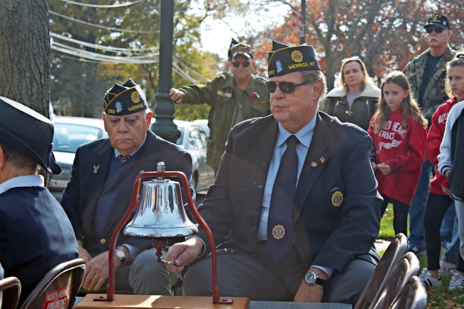 Post members Joe Ambrosino, left, and Lawrence Levy rung the bell for the Eleventh Hour ritual.
