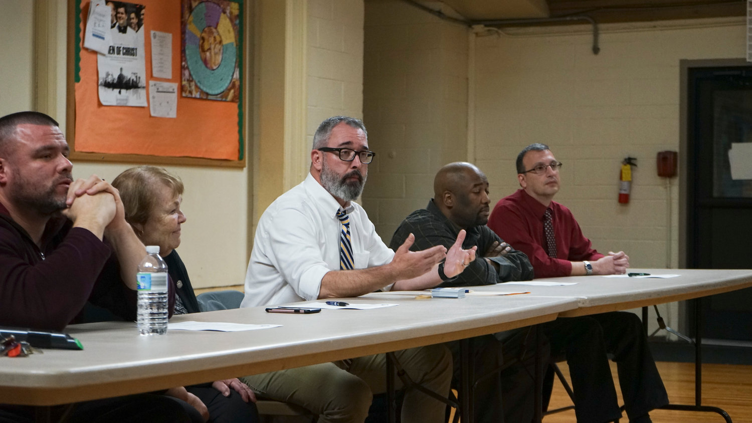 Joseph Trainor, center, executive director of the Martin De Porres Schools, addressed security concerns at a Nov. 6 meeting with Valley Stream residents.