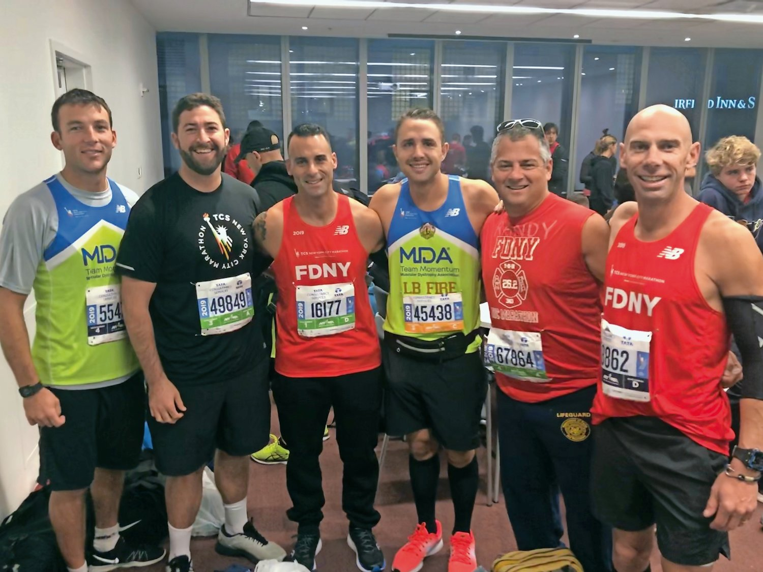 Long Beach residents Bryan Jones, far left, Devin Weinshank, Etan Blatt, Sam Pinto, Randy Eichin and Kelly Coyle before the start of the New York City Marathon on Nov. 3.