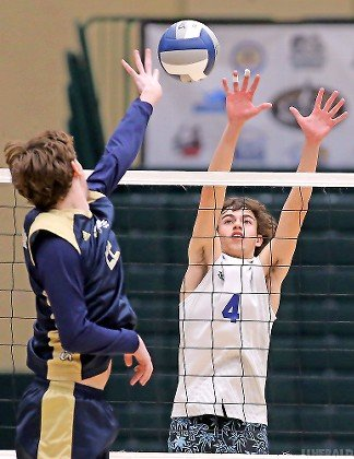 Long Beach's Dominick Cieleski, right, soared for a block during the Marines' sweep of Bethpage in the Nassau Class B boys' volleyball final.
