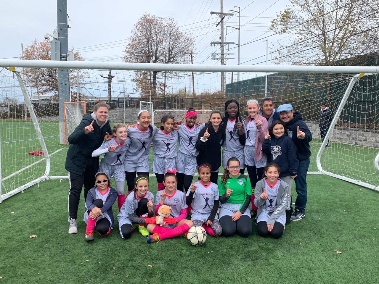 The division champion Blue Tornadoes. In front from left were, Blanca Esposito, Leora Herrmann, Leah Pisano (with TJ Mascot), Daniela Cantor-Moran, Brianna Ruiz and Tamar Pinchasov. Standing from left were trainer Kelly Wright, Isabella Vardaro, Aysu Unver, Alysha Lopez, Olivia Brown, Jane Marshalik, Chinello Obichere, Sara Sierzega, Madison Navarijo, and coaches Sabino Vardaro and Erwin Navarijo.
