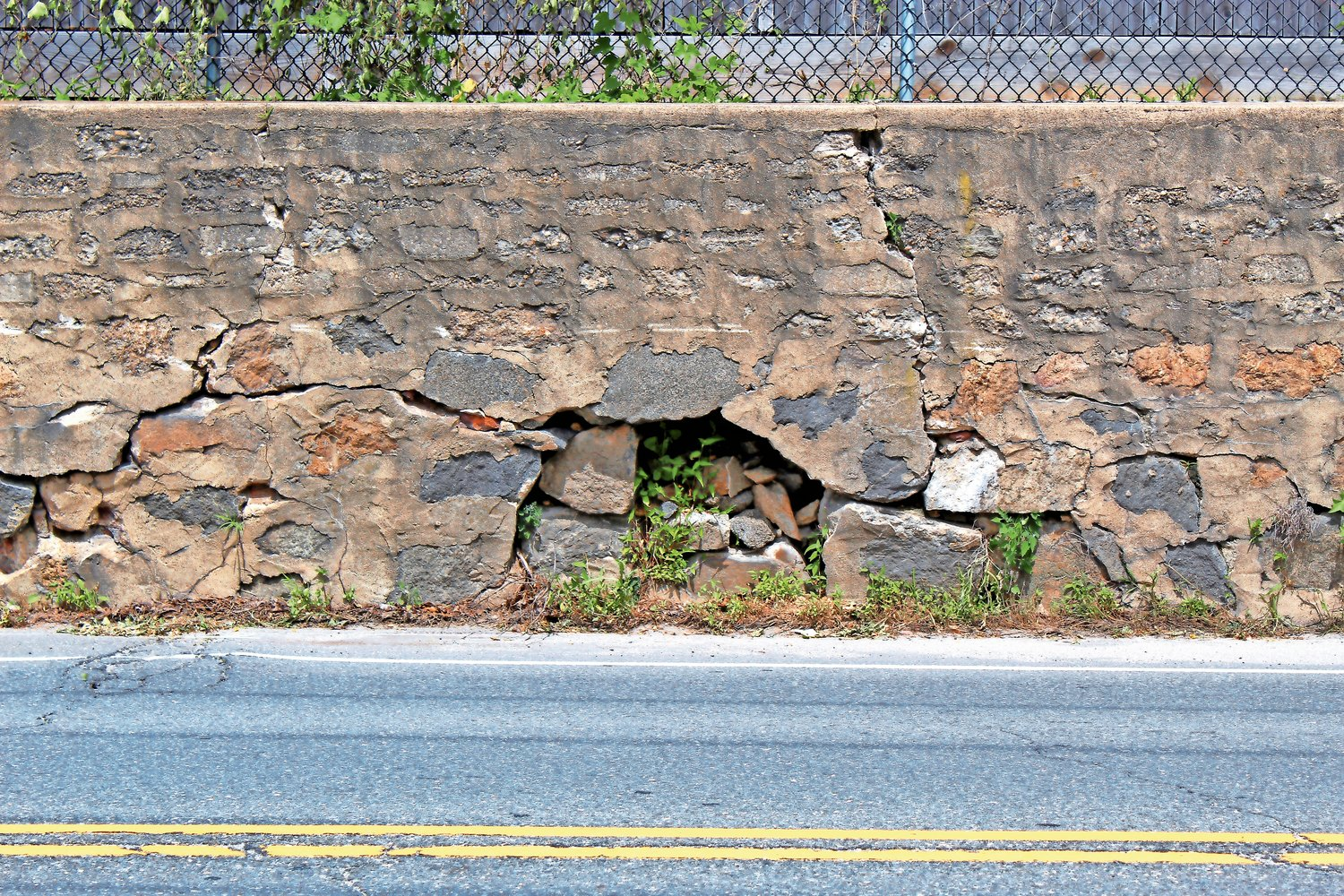 One of the most notable problems with the wall is a large cavity, shown here in June.