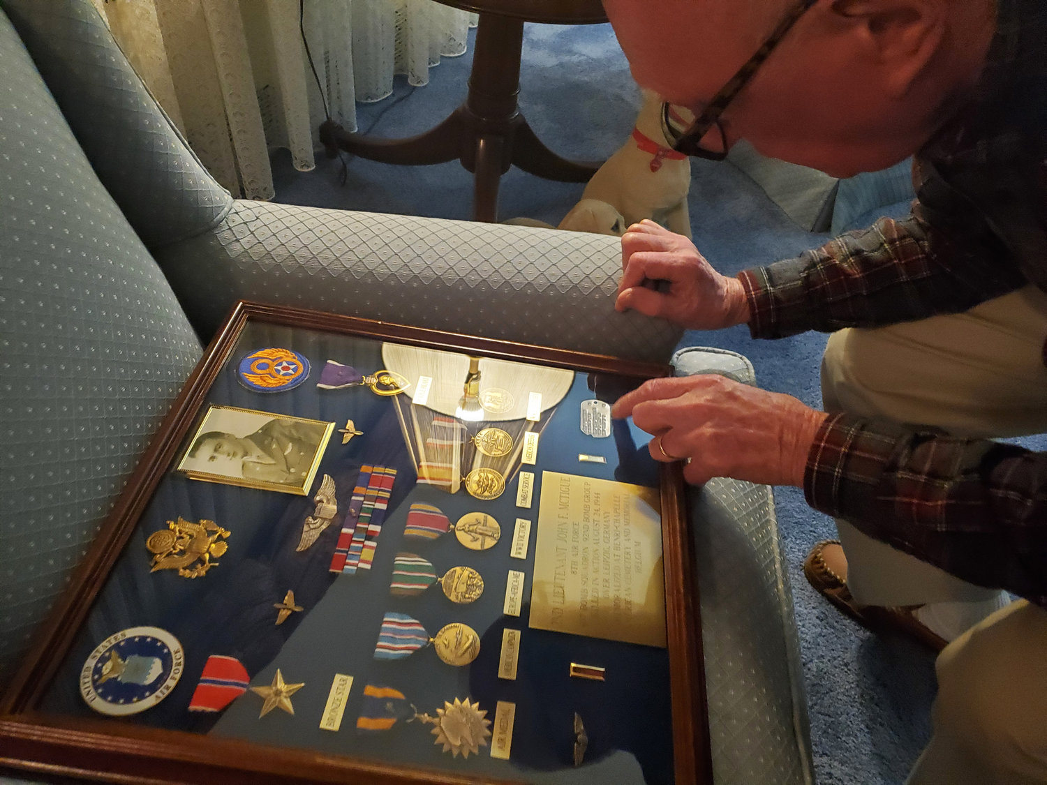 Tom McTigue looked over some of his brother John's Army memorabilia.