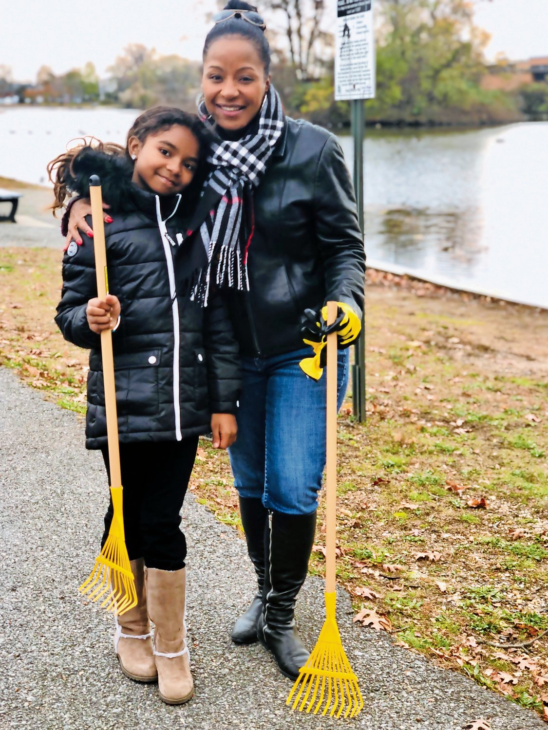 SMCCA Trustee Tricia Sattar, right, who is co-planning the Youth Club, brought along her daughter, Liyana, to the clean-up.