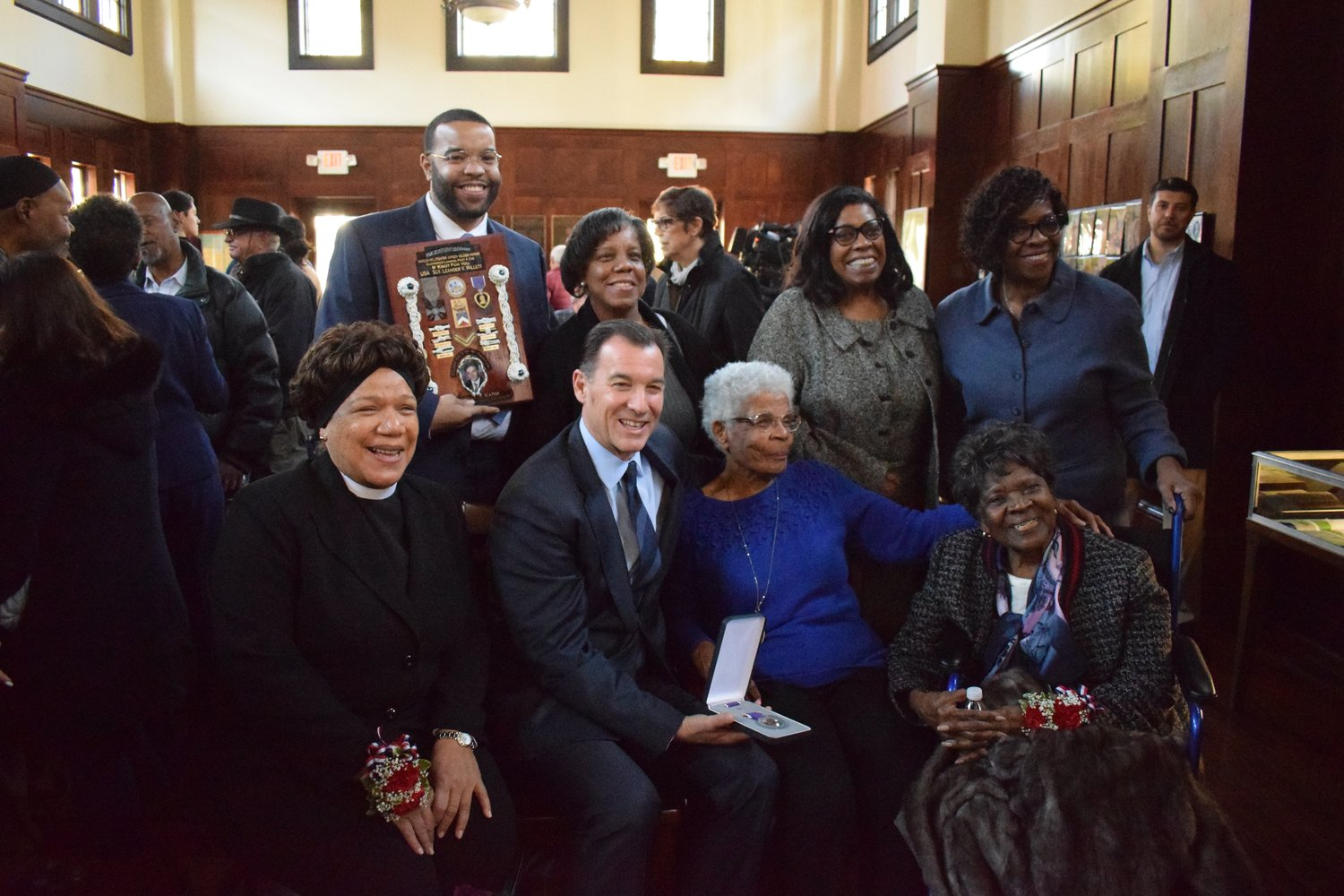 U.S. Rep. Tom Suozzi presented a Purple Heart to the family of the late Sgt. Leander Willett.
