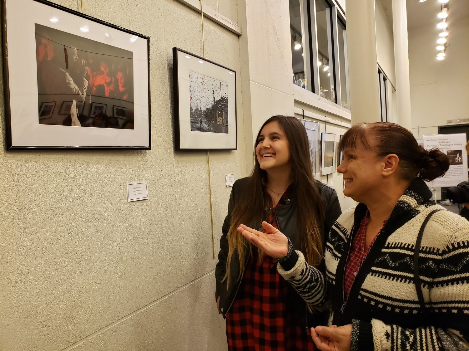 "Agostina Alfonso, 15, a sophomore at Freeport High School, with her photography teacher Lisa Pignataro and Agostino's photo ""Harry Styles,"" for which she was recognized at a Long Island Arts Council at Freeport show at the village library on Tuesday."