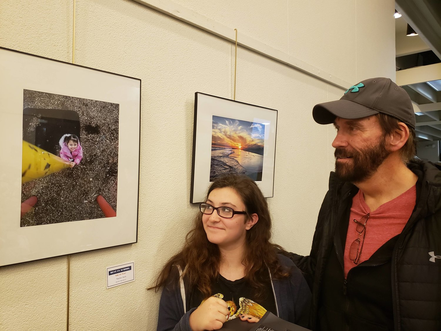 Baldwinite Heather Ilardi, 15, left, showed her grandfather Bill Gardner, from Riverhead, who is also a photographer, her Best in Show-winning photo.