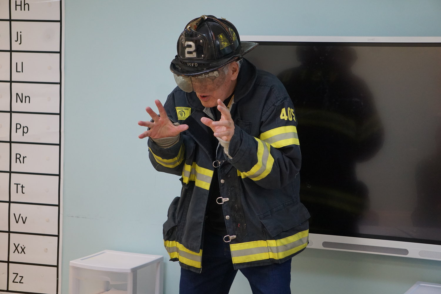 Longtime Valley Stream firefighter Fred Gless explained how a firefighter's helmet works to a class of special-education students on Nov. 15.