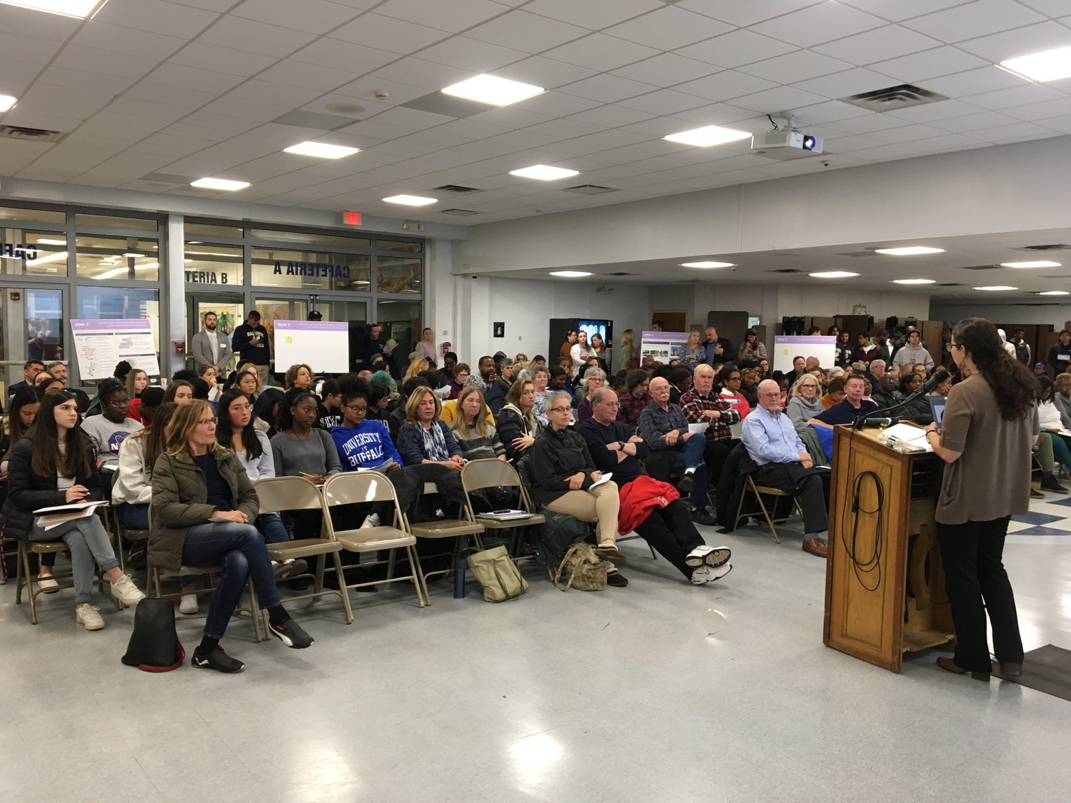 Abi Rudow, of VHB Engineering, a consulting team working on the Downtown Revitalization Initiative, spoke to residents at a community meeting at Baldwin High School on Nov. 20.