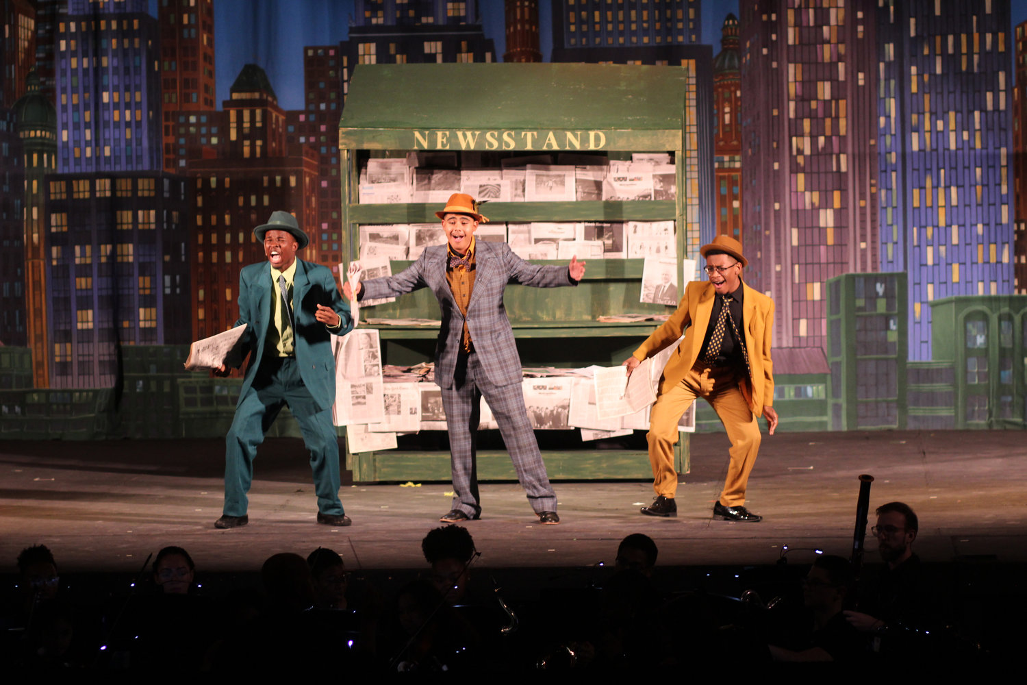 "Baldwin High School students performed ""Guys and Dolls"" last weekend. In the opening number, ""Fugue for Tinhorns,"" gamblers Benny Southstreet, Nicely-Nicely Johnson and Rusty Charlie, played by Chris Holman, Daniel Polonia and Jaylin Thomas, set the stage for the classic story of love and gambling in 1920s Times Square."