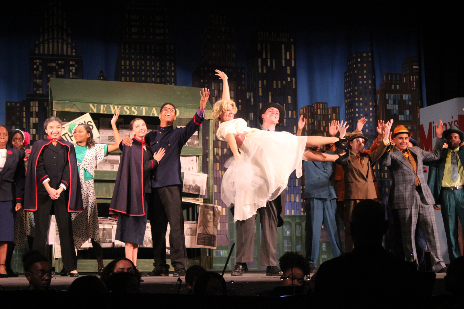 "The crowd cheered during the grand finale of the high school's musical production ""Guys and Dolls."" Starring in the show were Juliet Hugues, left, and Wilbert Diaz as Sarah Brown and Sky Masterson; Emily Orgill and Thomas Dean, right, as Adelaide and Nathan Detroit."