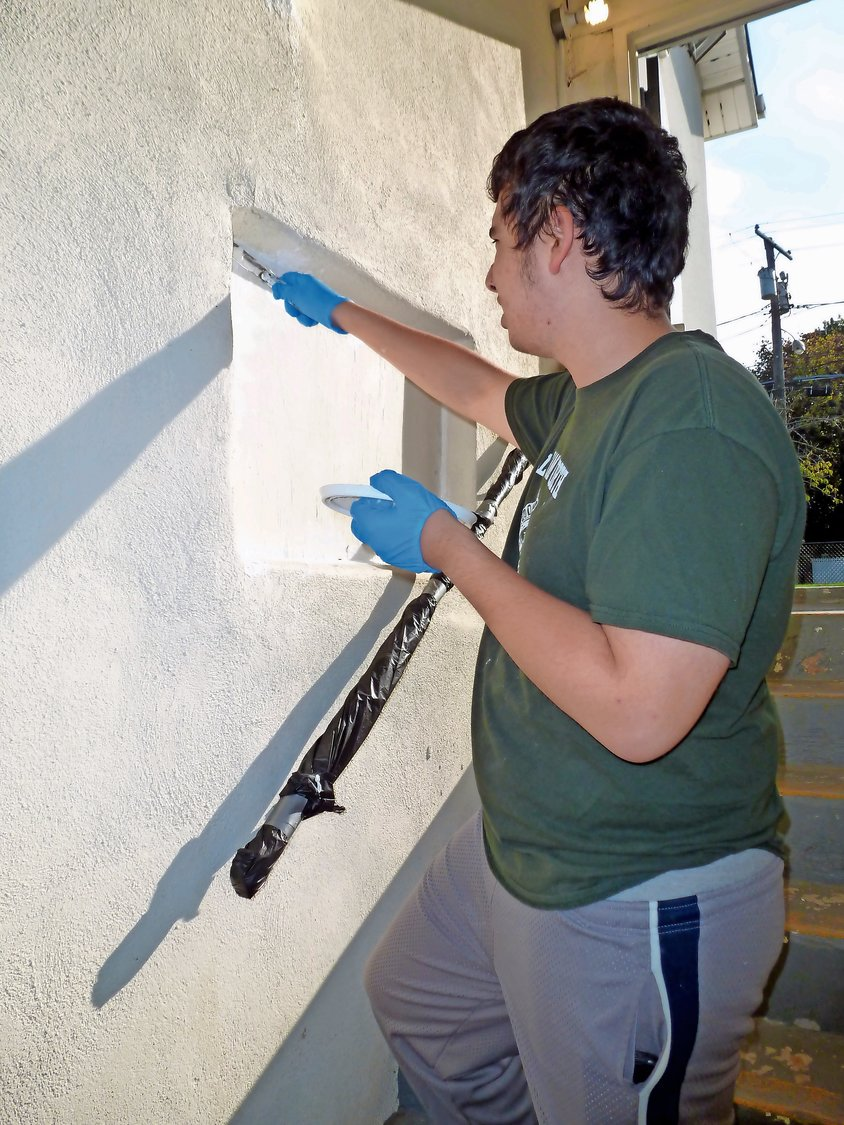 Boy Scout Tracy Colena, 18, painted the stairway at the post as part of his Eagle Scout project.