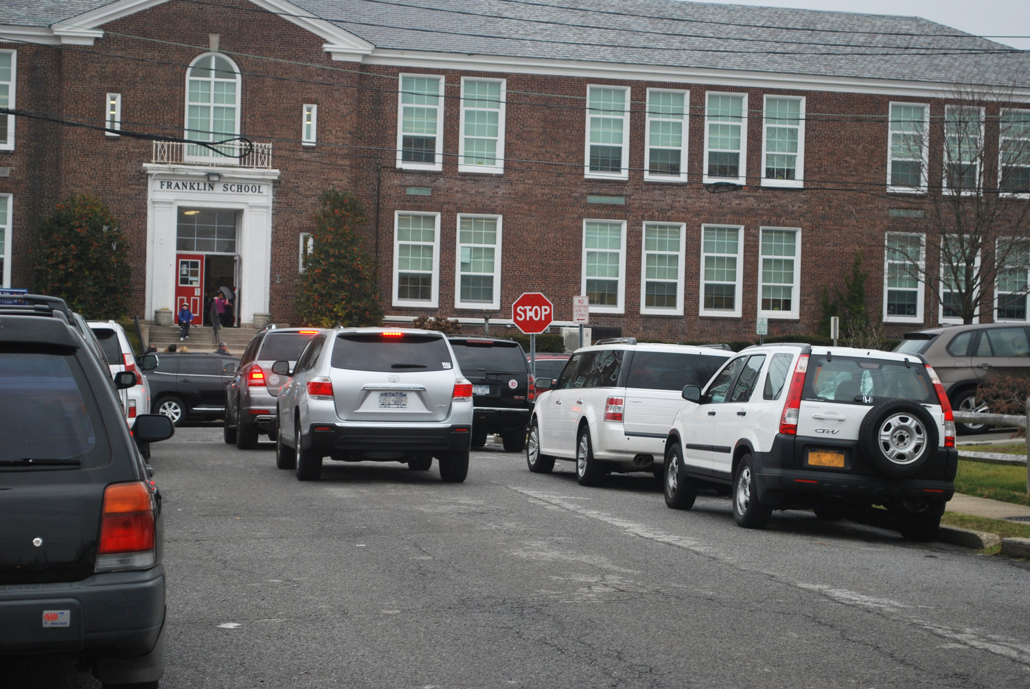 Hewlett resident Carmen Durdaller called traffic volume at pickup and dismissal at the Franklin Early Childhood Center crazy. The photo from December 2013 shows nothing has changed in nearly six years.