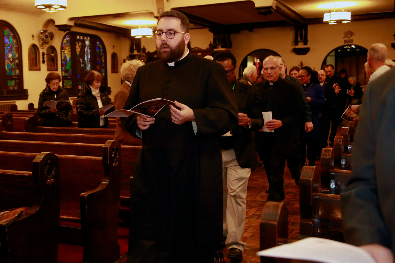 The Rev. Michael Duffy, of Our Lady of Lourdes, led the procession of clergy during the annual Thanksgiving Interfaith Worship Service last Sunday.