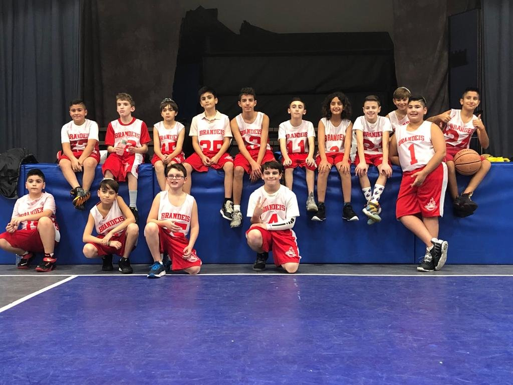 This season's Brandeis MaccaBees basketball team. From left onstage were Maor Shabty, Isaac Samuelson, Branden Beshkin, Yaakov Aronbayev, Orel Stein, Jordan Carucci, Liron Karudo, Tal Kerity, Eili Greenblatt, Natan Shabtay, standing, and Jaden Abramov. Kneeling from left were Inon Azour, Lior Matsui, Motti Gozenpud and Jacob DeMarco. Not pictured, coach Haim Shmuel.