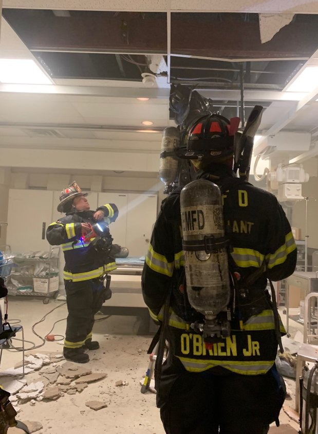 Firefighters took a final look at the origin of the fire to ensure there was no extension to the floor above the ceiling.