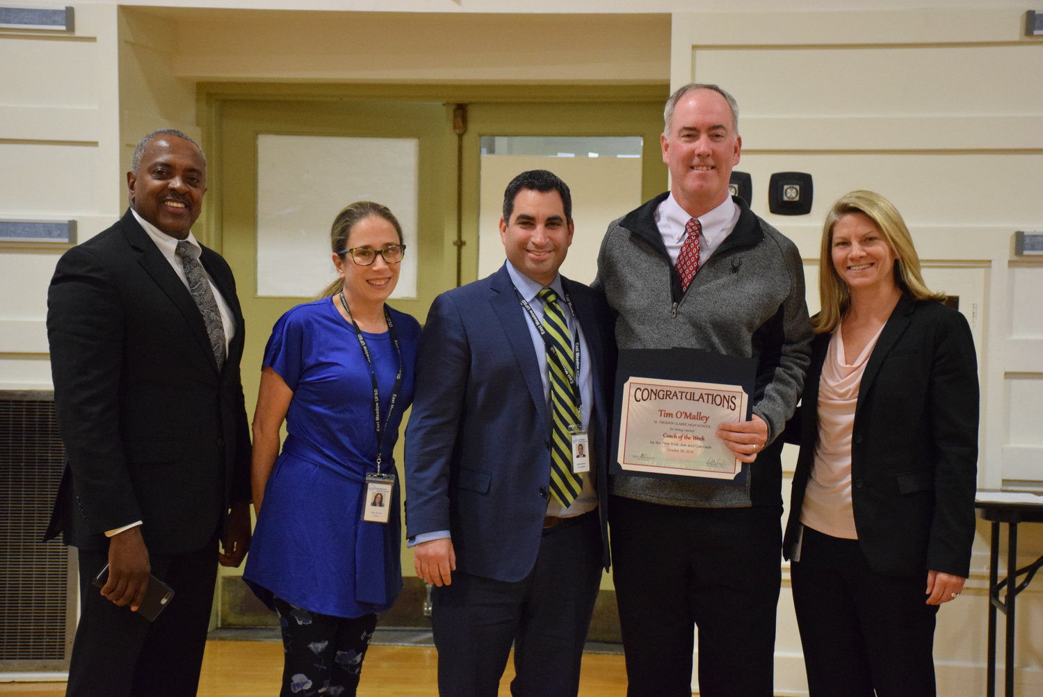 W.T. Clarke High School football coach Tim O'Malley, second-from-right, earned the High School Coach of the Week by the New York Jets. He was with Superintendent Dr. Kenneth Card Jr., left, Board Vice President Alisa Baroukh, Board President Matthew Melnick and Director of Health, Physical Education and Athletics Kristi Detor.