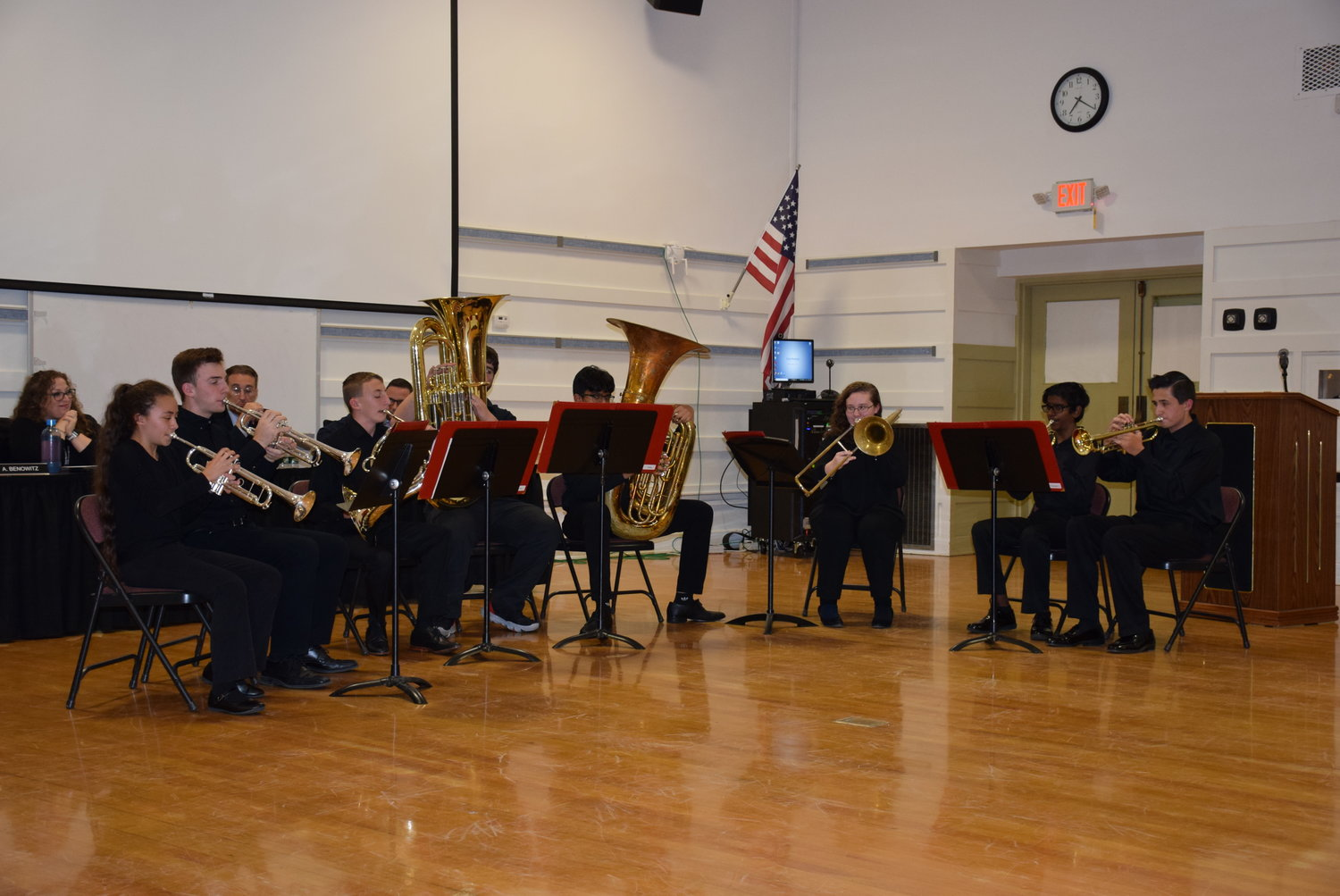 The East Meadow High School Brass Ensemble performed a selection of pieces for attendees of the board meeting.